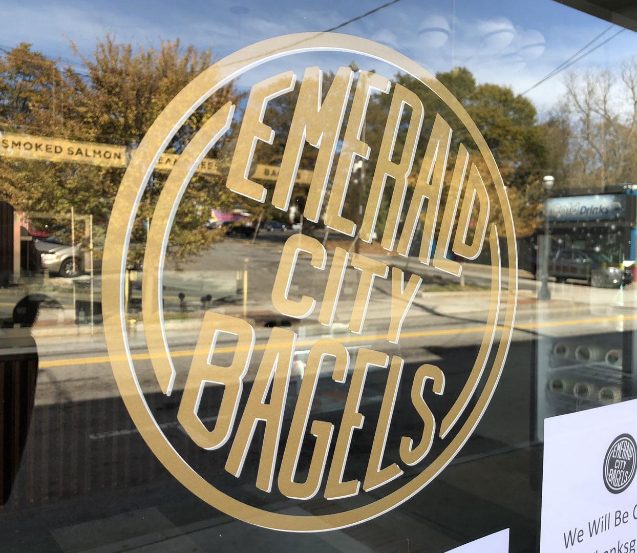 Emerald City Bagel logo on door